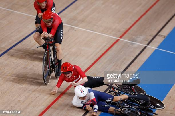 Denmark's Frederik Madsen crashes with Great Britain's Charlie Tanfiled during the first round heats of the men's track cycling team pursuit during...
