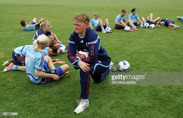 Denmark's goalkeeper Heidi Johansen warms up with her teammates during a training session for the Women's World Cup 2007 football match in Wuhan in...