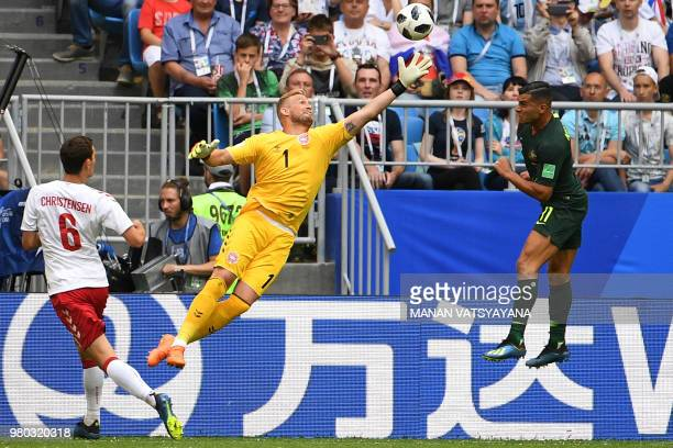 Denmark's goalkeeper Kasper Schmeichel comes for a high ball against Australia's forward Andrew Nabbout during the Russia 2018 World Cup Group C...