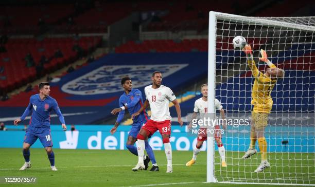 Denmark's goalkeeper Kasper Schmeichel dives to save a header from England's midfielder Mason Mount during the UEFA Nations League group A2 football...