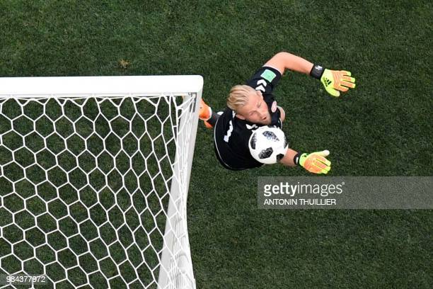 TOPSHOT Denmark's goalkeeper Kasper Schmeichel jumps to make a save during the Russia 2018 World Cup Group C football match between Denmark and...