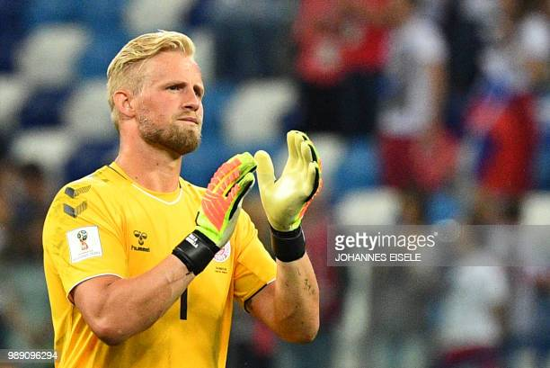 Denmark's goalkeeper Kasper Schmeichel looks dejected after being defeated in the penalty shootout at the end of the Russia 2018 World Cup round of...