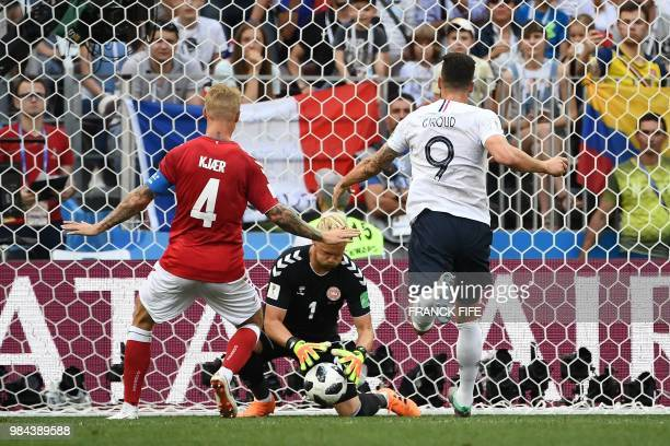 TOPSHOT Denmark's goalkeeper Kasper Schmeichel makes a save during the Russia 2018 World Cup Group C football match between Denmark and France at the...