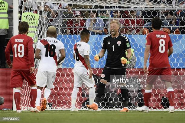 Denmark's goalkeeper Kasper Schmeichel reacts after Peru's midfielder Christian Cueva failed his penalty kick during the Russia 2018 World Cup Group...