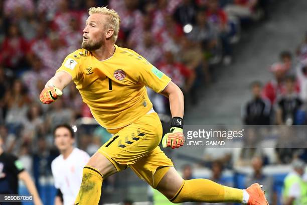 TOPSHOT Denmark's goalkeeper Kasper Schmeichel reacts during the Russia 2018 World Cup round of 16 football match between Croatia and Denmark at the...