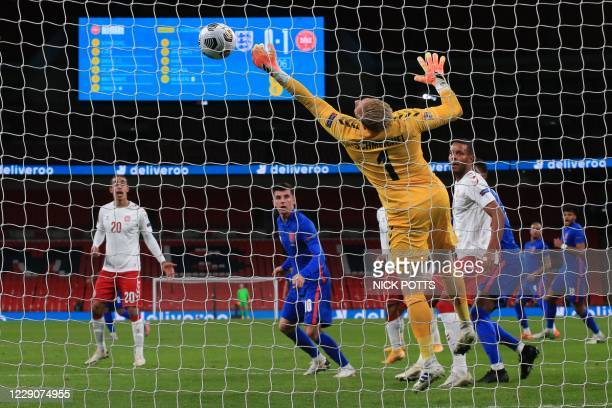 Denmark's goalkeeper Kasper Schmeichel saves from a header from England's midfielder Mason Mount during the UEFA Nations League group A2 football...