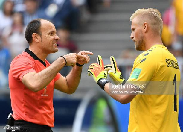 Denmark's goalkeeper Kasper Schmeichel talks with Spanish referee Antonio Mateu Lahoz during the Russia 2018 World Cup Group C football match between...