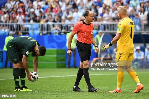 Denmark's goalkeeper Kasper Schmeichel talks with Spanish referee Antonio Mateu Lahoz as Australia's midfielder Mile Jedinak prepares to take a...