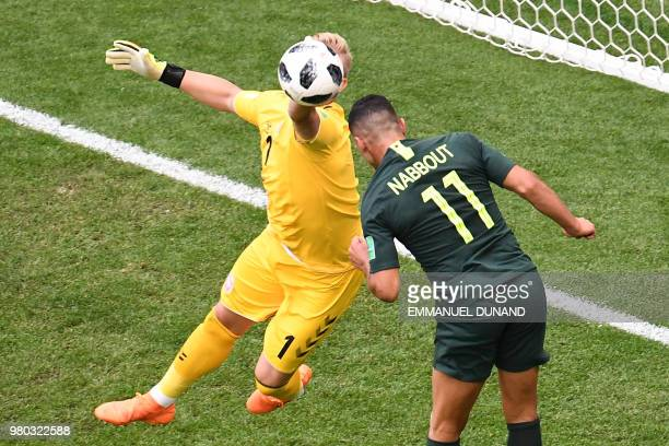 Denmark's goalkeeper Kasper Schmeichel vies vies for the ball with Australia's forward Andrew Nabbout during the Russia 2018 World Cup Group C...