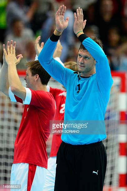 Denmark's goalkeeper Niklas Jacobsen applauds after defeating Spain at the end of the men's preliminaries Group A handball match Denmark vs Spain for...