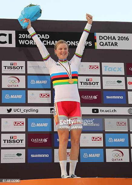 Denmark's gold medallist Amalie Dideriksen celebrates on the podium at the end of the women's elite road race event as part of the 2016 UCI Road...