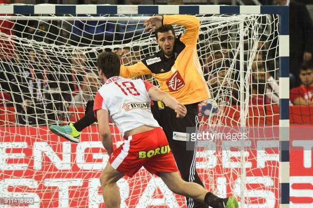Denmark's Hans O Lindberg scores past France's goalkeeper Cyril Dumoulin during the match for third place of the Men's 2018 EHF European Handball...