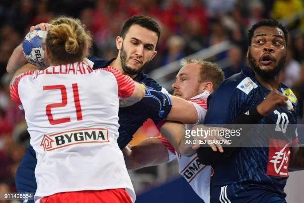 Denmark's Henrik Toft Hansen and Denmark's Henrik Mollgaard Jensen hold off France's Romain Lagarde as France's Cedric Sorhaindo looks on during the...