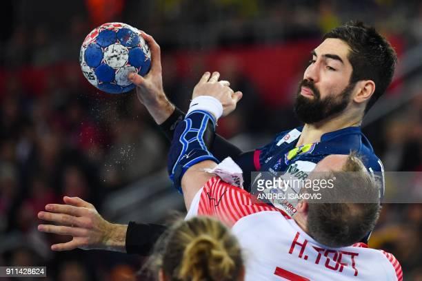 Denmark's Henrik Toft Hansen defends against France's Nikola Karabatic during the match for third place of the Men's 2018 EHF European Handball...
