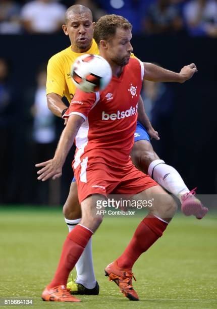 Denmark's Hjalte Norregaard vies with Brazil's Djalminha during the Star Sixes semifinal football match between Denmark and Brazil at the O2 Arena in...
