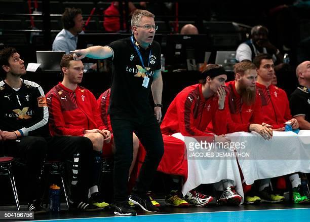 Denmark's Icelandic head coach Gudmundur Gudmundsson gestures during the Golden League handball match between Denmark and Norway on January 9 2016 at...
