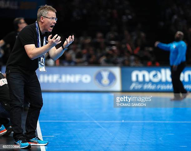 Denmark's icelandic head coach Gudmundur Gudmundsson gives his instructions during the 25th IHF Men's World Championship 2017 Group D handball match...