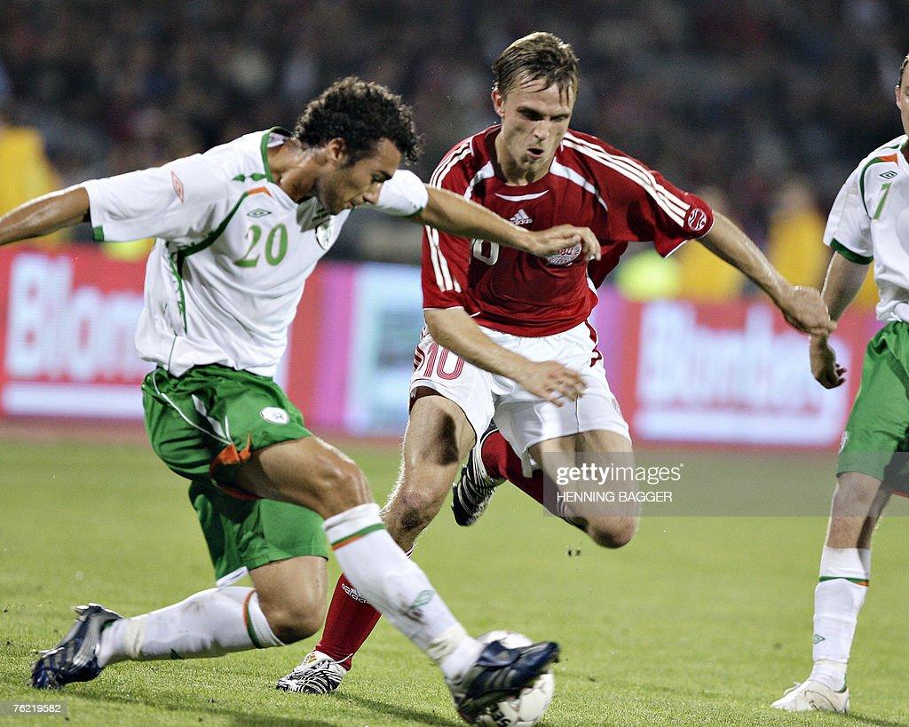 Denmark's Jesper Groenkjaer (R) is stopped by Ireland's Stephen Kelly in the friendly football match 22 August, 2007 in Aarhus, 200 kilometres west of Copenhagen. AFP PHOTO /HENNING BAGGER/ Scanpix Denmark