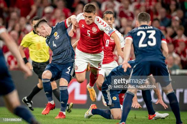Denmark's Joakim Mahle and Scotland's Billy Gilmour vie for the ball during the 2022 FIFA World Cup qualifier group F football match between Denmark...