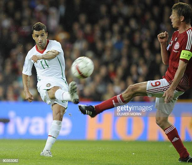 Denmark's Jon Dahl Tomasson struggles for the ball with Portugal's Simao Sabrosa during the FIFA World Cup 2010 qualifying match Denmark vs Portugal...