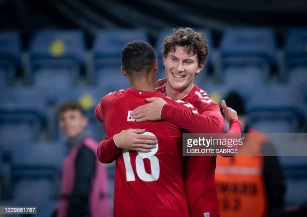 Denmark's Jonas Wind is hugged by Denmark's Alexander Bah after scoring the 1-0 during the international friendly football match Denmark v Sweden in...