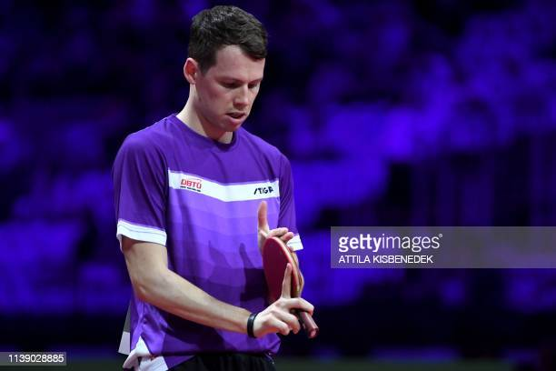 Denmark's Jonathan Groth checks his racket prior to his match against South Korea's Jang WooJin on April 24 2019 during the 2019 ITTF World Table...