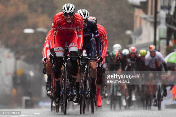 Denmark's Kasper Asgreen leads a group up Parliament Hill in Harrogate, northern England, on September 29, 2019 as they compete in the Men's Elite...