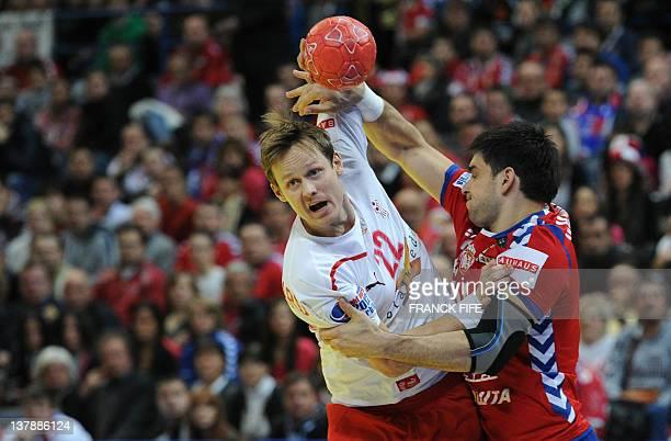 Denmark's Kasper Sondergaard Sarup vies with Serbia's Nenad Vuckovic during the men's EHF Euro 2012 Handball Championship final Serbia vs Denmark on...