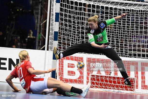 TOPSHOT Denmark's Kathrine Heindahl throws the ball to score past f's goalkeeper Amandine Leynaud during the Women's European Handball Championship...