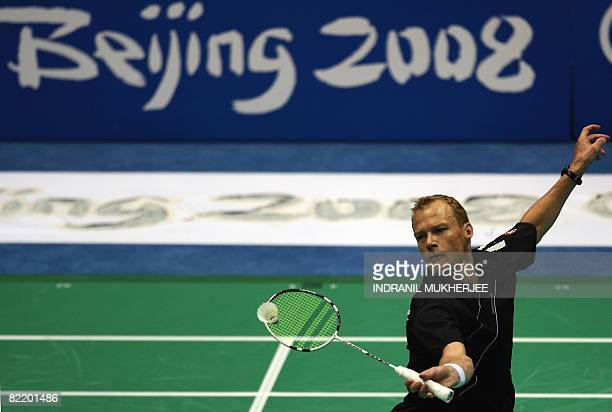 Denmark's Keneth Jonassen plays a shot during a training session in Beijing on August 7 2008 on the eve of the opening ceremony of the 2008 Beijing...