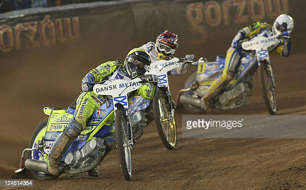Denmark's Kenneth Bjerre Russia's Emil Sayfutdinov and Poland's Tomasz Gollob compete during the FIM Speedway Grand Prix 2011 at Vojens' Speedway...