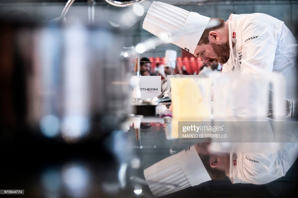 TOPSHOT - Denmark's Kenneth Toft-Hansen competes during the event of the Bocuse d'Or Europe 2018 International culinary competition, on June 12, 2018 in Turin.