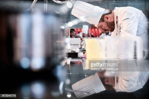 TOPSHOT Denmark's Kenneth ToftHansen competes during the event of the Bocuse d'Or Europe 2018 International culinary competition on June 12 2018 in...
