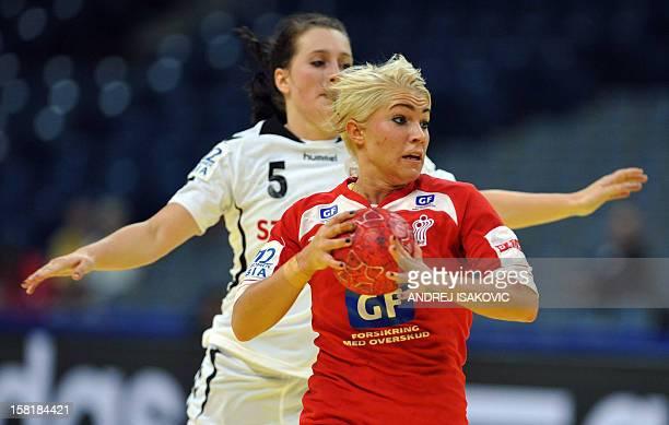 Denmark's Kristina Kristiansen runs past Czech's Katerina Keclikova during their Women's EHF Euro 2012 Handball Championship match Czech Republic vs...