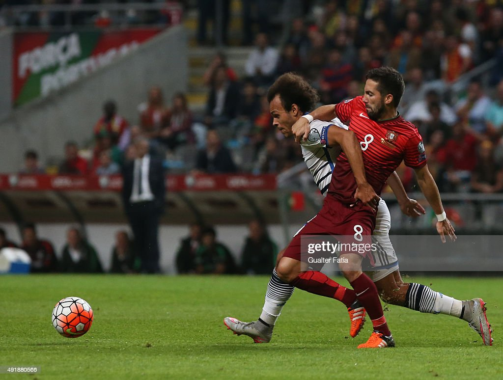 Denmark's Lars Jacobsen with Portugal's midfielder Joao Moutinho in action during the UEFA EURO 2016 Qualifier match between Portugal and Denmark at Estadio Municipal de Braga on October 8, 2015 in Braga Portugal.