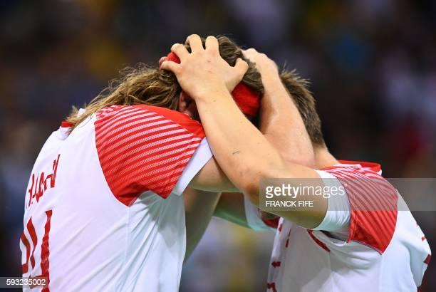 TOPSHOT Denmark's left back Mikkel Hansen and centre back Morten Olsen celebrate winning the men's Gold Medal handball match Denmark vs France for...