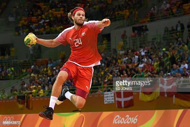 Denmark's left back Mikkel Hansen jumps to shoot during the men's preliminaries Group A handball match Denmark vs Croatia for the Rio 2016 Olympics...