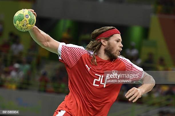 TOPSHOT Denmark's left back Mikkel Hansen jumps to shoot during the men's quarterfinal handball match Denmark vs Slovenia for the Rio 2016 Olympics...