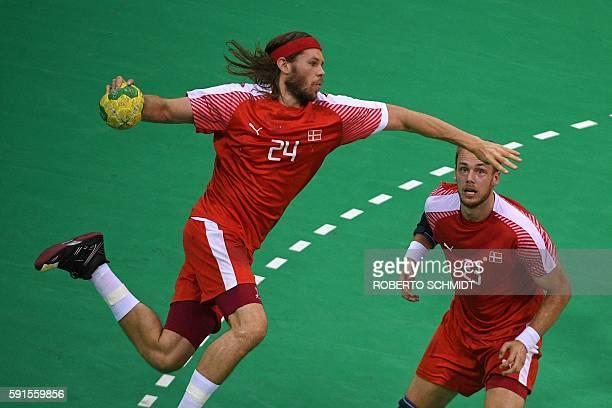 Denmark's left back Mikkel Hansen shoots past Denmark's left back Henrik Hansen during the men's quarterfinal handball match Denmark vs Slovenia for...