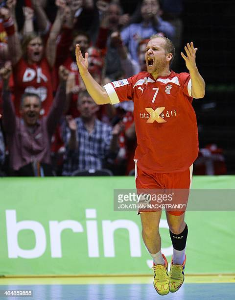 Denmark's left wing Anders Eggert Magnussen celebrates after scoring a goal during the men's EHF Euro 2014 Handball Championship semifinal match...