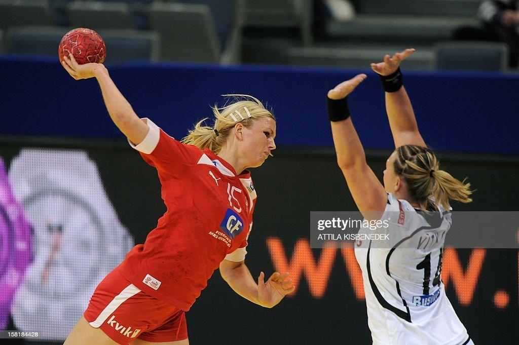 Denmark's leftback Pernille Larsen (L) scores a goal past Czech Petra Vitkova (R) on December 10 , 2012 during a women's 2012 EHF European Handball Championship Group II match at the KOMBANK arena in Belgrade. KISBENEDEK