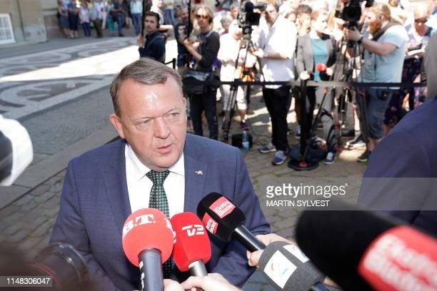 Denmark's Liberal Prime Minister Lars Lokke Rasmussen talks to the press as he leaves Amalienborg Castle, in Copenhagen, Denmark, where he announced...