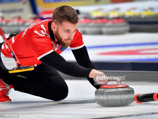 Denmark's Mads Noergaard in action during the Men's semifinal between Denmark and Switzerland at the European Curling Championships in Helsingborg...