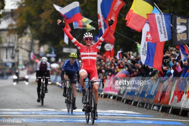 TOPSHOT Denmark's Mads Pedersen celebrates his victory as he crosses the line in Harrogate to win the Men's Elite Road Race at the 2019 UCI Road...