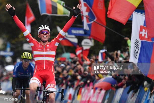 Denmark's Mads Pedersen celebrates his victory as he crosses the line in Harrogate to win the Men's Elite Road Race at the 2019 UCI Road World...