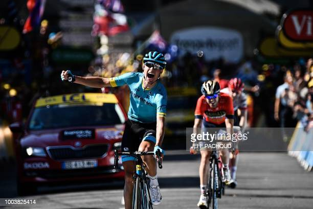 TOPSHOT Denmark's Magnus Nielsen celebrates as he crosses the finish line to win ahead of Spain's Jon Izagirre and Netherlands' Bauke Mollema the...