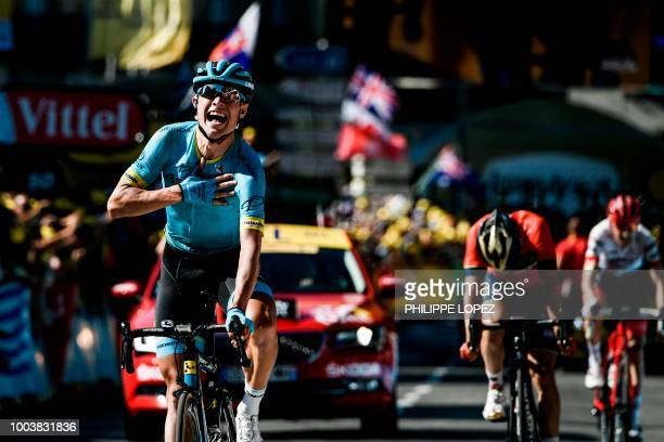 Denmark's Magnus Nielsen celebrates as he crosses the finish line to win ahead of Spain's Jon Izagirre and Netherlands' Bauke Mollema the 15th stage...