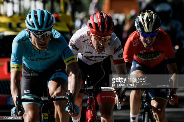 Denmark's Magnus Nielsen Netherlands' Bauke Mollema and Spain's Jon Izagirre ride during their breakaway in the last kilometers of the 15th stage of...
