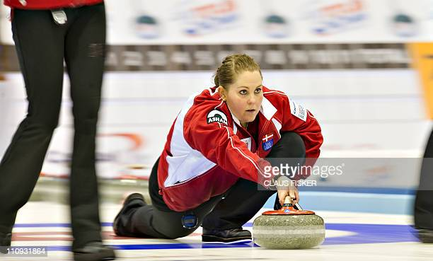 Denmark's Maria Poulsen watches the line of her shot during her team's bronze medal match against China at the women's World Curling Championships in...
