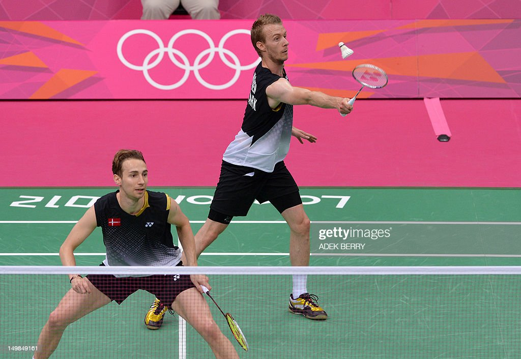 Denmark's Mathias Boe (Foreground) and Carsten Mogensen play against China's Cai Yun and Fu Haifeng in the Men's Doubles badminton gold medal match at the London 2012 Olympic Games in London, on August 5, 2012.